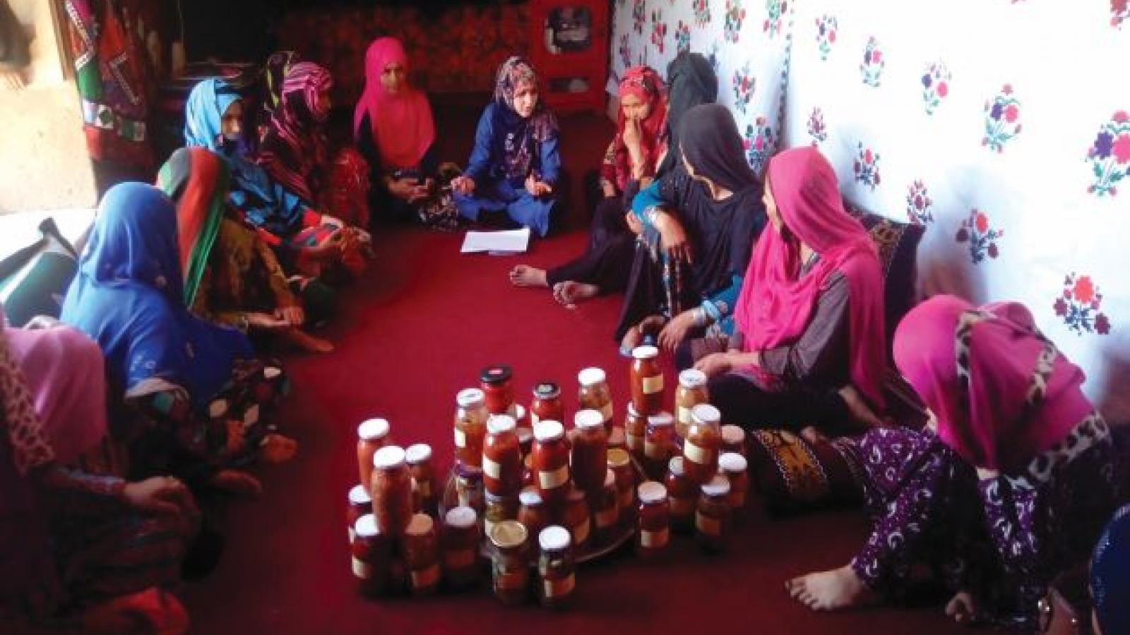 Saleha and the women in the self-help group with the fermented vegetables