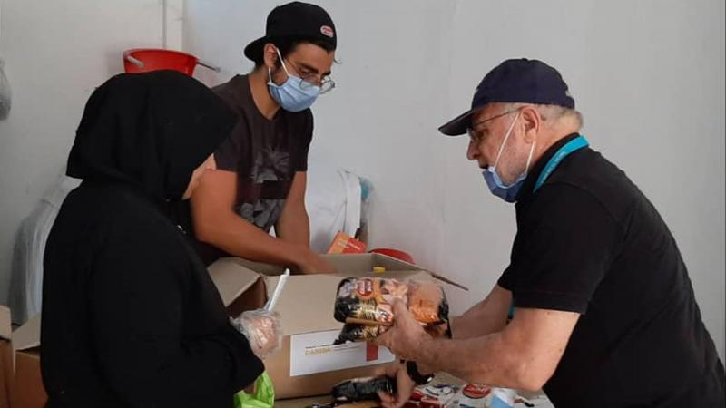 Lebanese beneficiary receiving critical food items worth one month of consumption