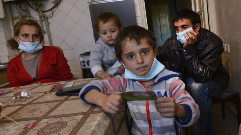 Family fleeing from bombs: We need food and medicine